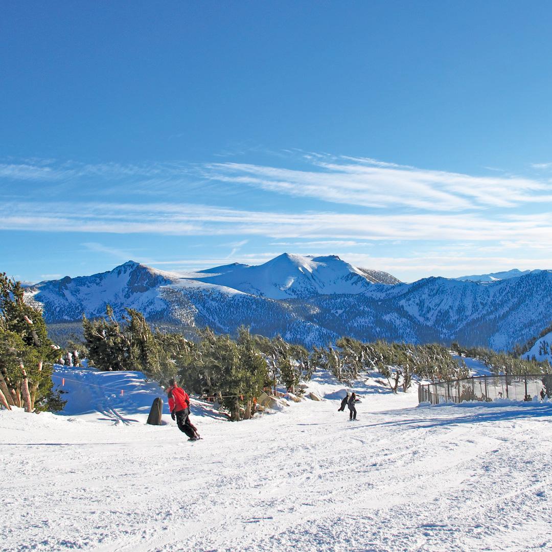 two snowboarders enjoying Heaveny ski resort in Tahoe