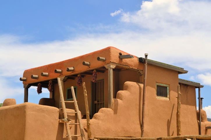 Red adobe structure at Taos Pueblo, New Mexico.