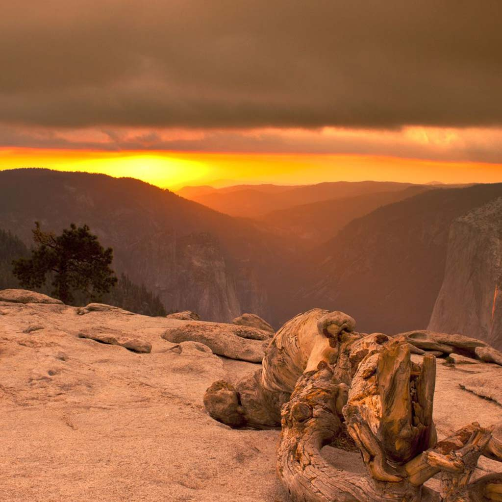 View of the sun going down from the bare rock at Sentinal Dome in Yosemite park.