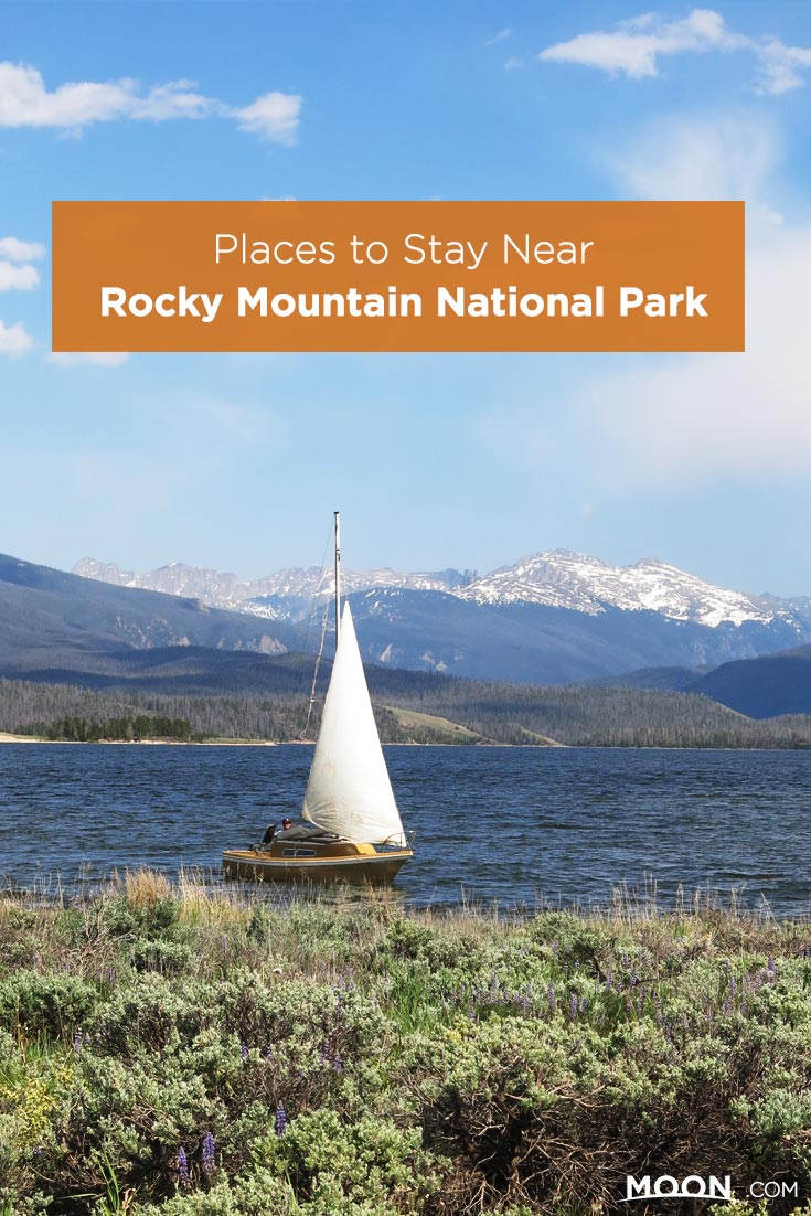 Places to Stay Near Rocky Mountain National Park text on a photo of a sailboat on Granby Lake.