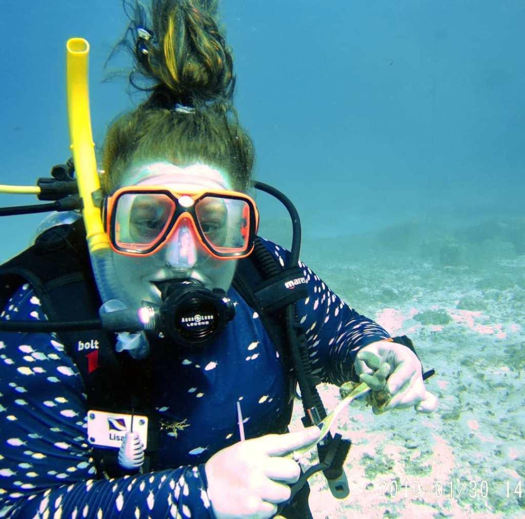 Underwater diving photo of plus size scuba
