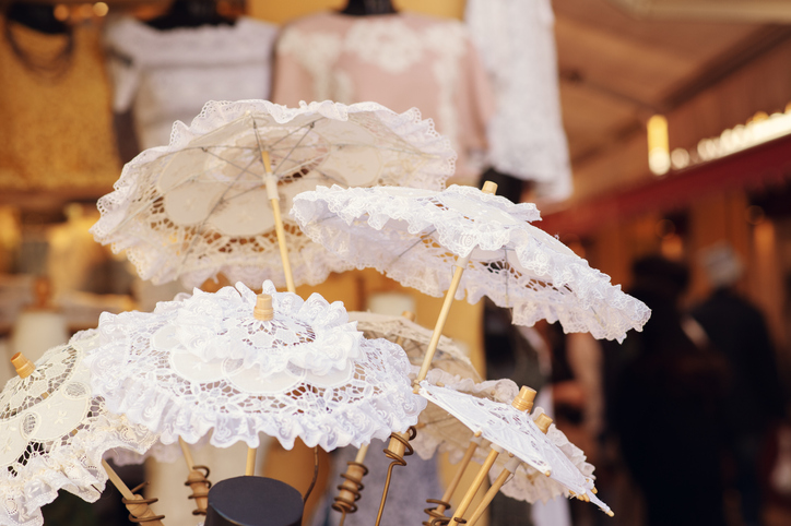 White lace umbrellas on the island of Burano, shop with lace, Venice, Italy