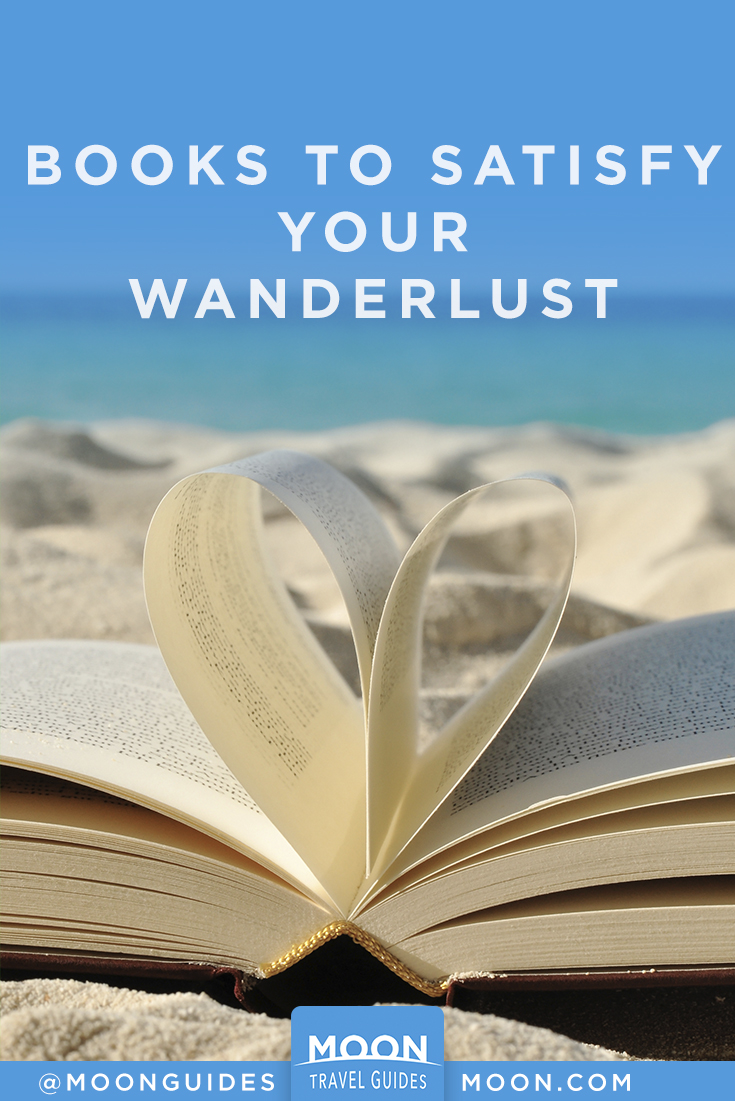 pinterest graphic that reads: Books to satisfy your wanderlust. Photo of a book on the beach.
