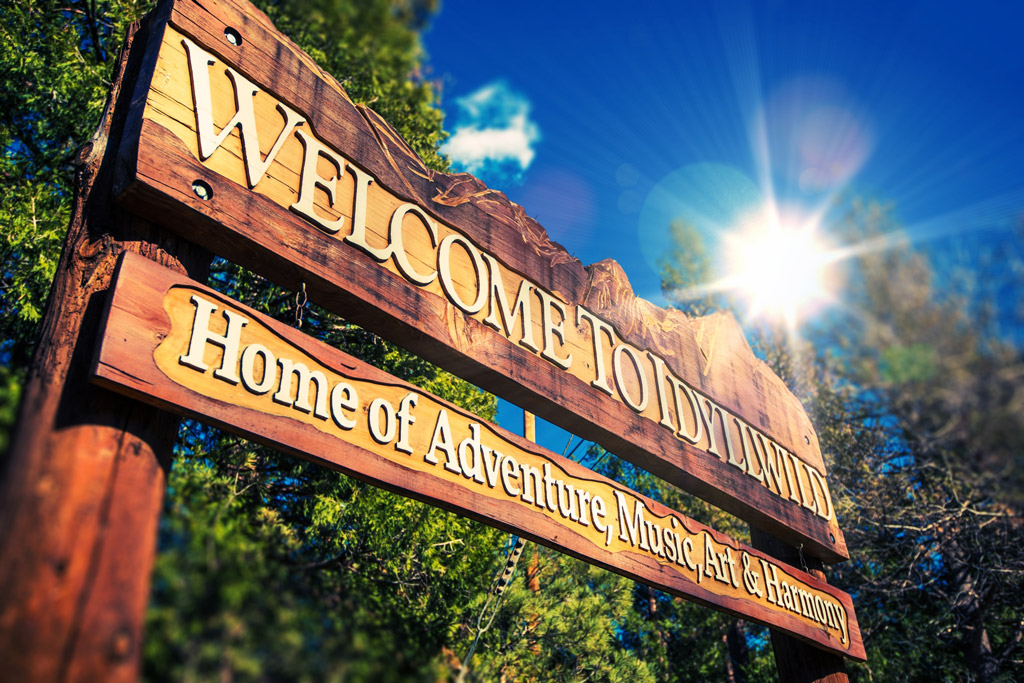 Sign that reads: Welcome to Idyllwild: Home of Adventure, Music, Art & Harmony