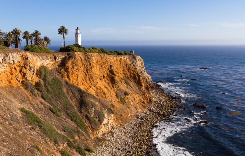 lighthouse on a cliff on the california coast