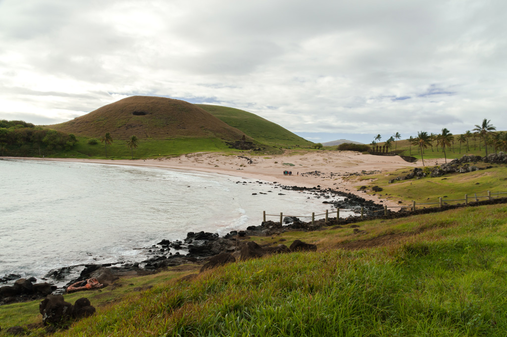 photo of tropical Anakena beach with mounds in the distance