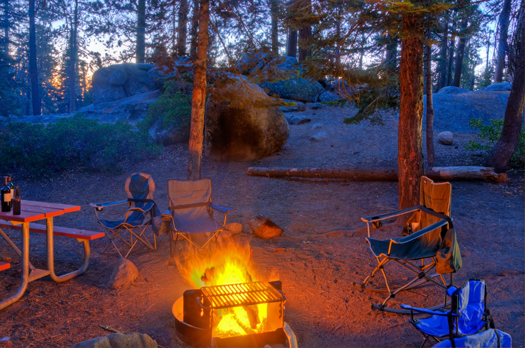 chairs around a campfire at night in Kings Canyon