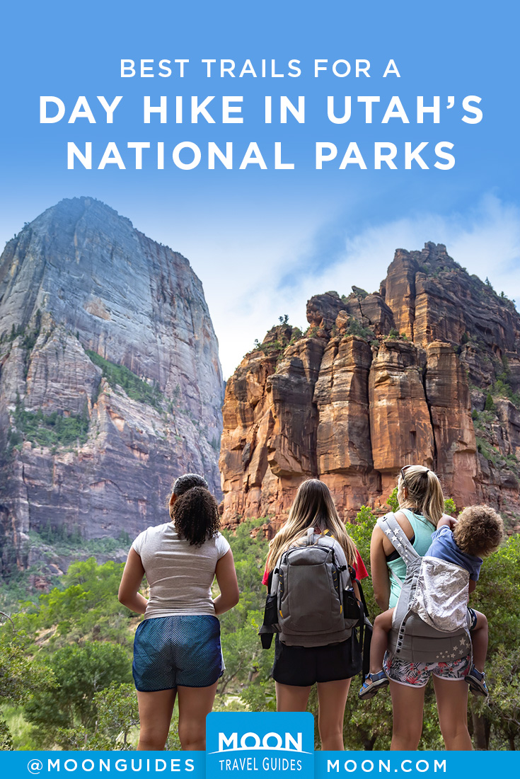 pinterest graphic depicting three hikers looking up at gigantic rock formations in utah with overlaid text reading day hike in utah's national parks