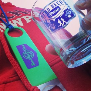 "A bottle opener ""medal"" and sampler glass were some of the 2014 Bend Beer Chase finisher awards."
