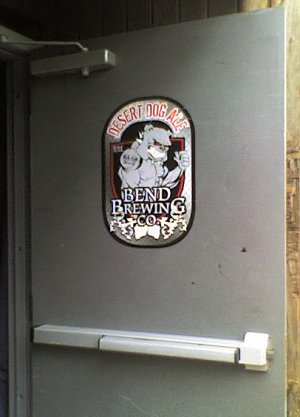 Desert Dog Ale from Bend Brewing Company posted on a door