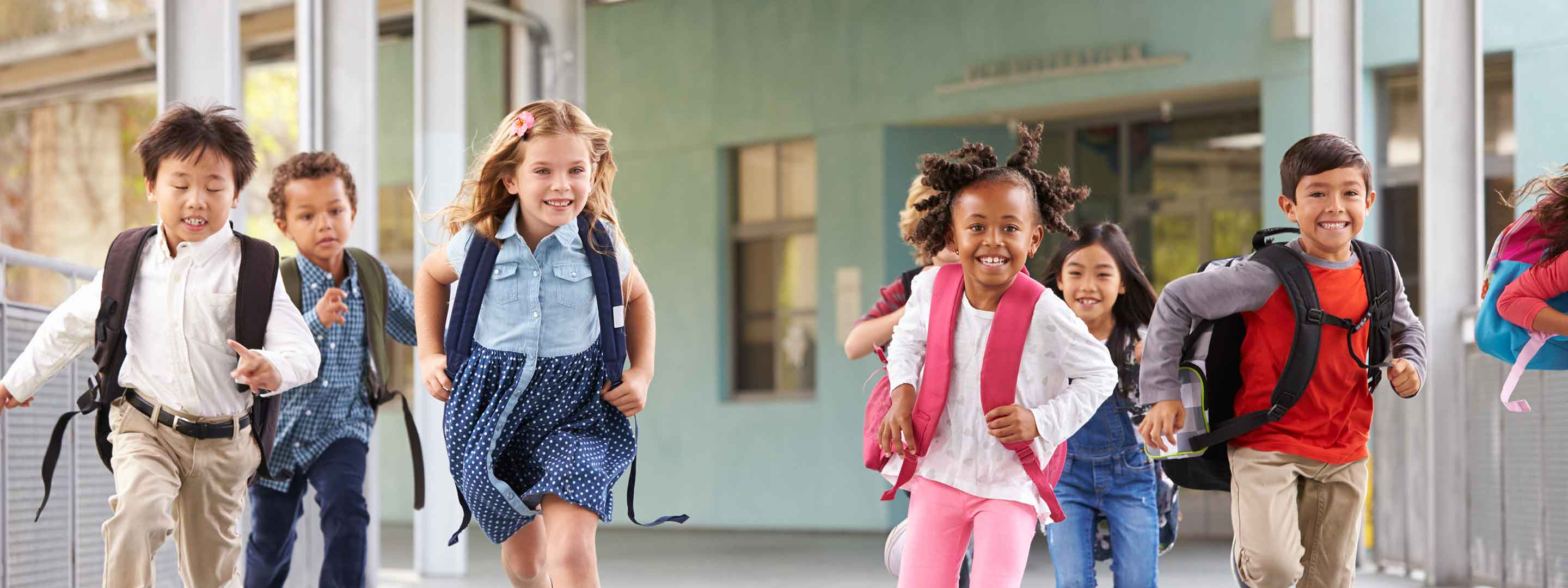 Kids running outside of their school