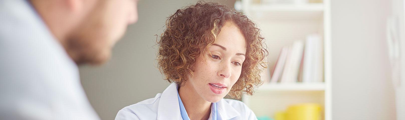 Audiologist talking to a patient about Meniere's Disease