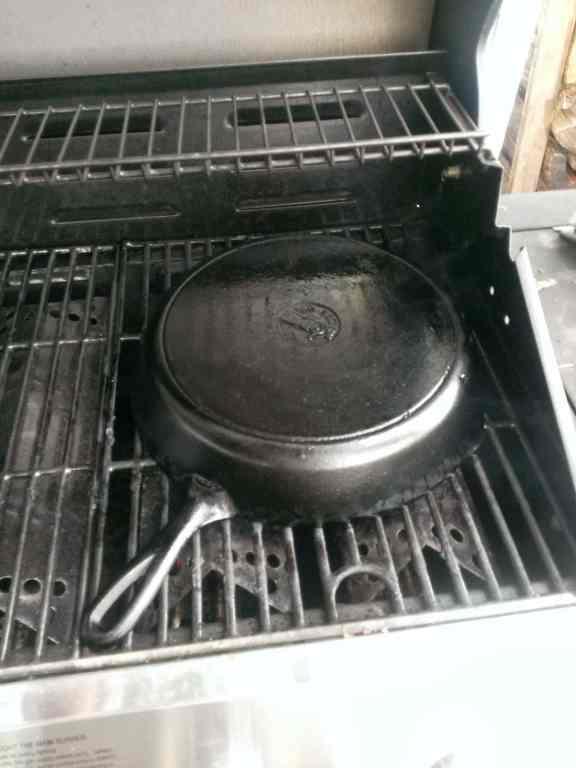 Seasoning cast iron on grill