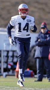 Photo Credit: John Wilcox - Wide receiver #14 Michael Floyd warms up for Patriots practice at Gillette.