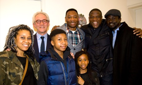 A triumphant Benjamin Ogbebor, his family, and Dr Robert Travers (2nd from left.)