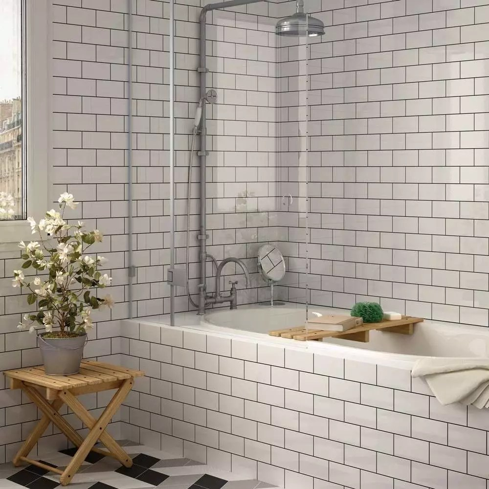 white subway tile with black grout