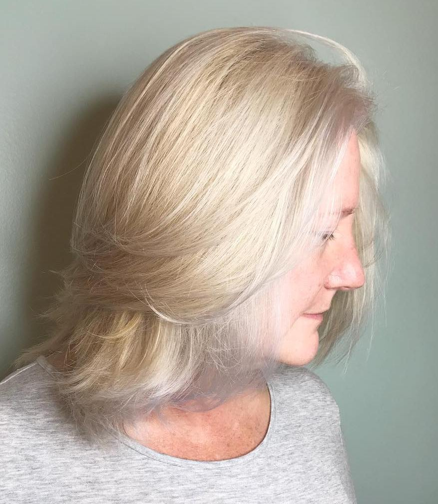 Medium Straight Layered Light Blonde Hairstyle