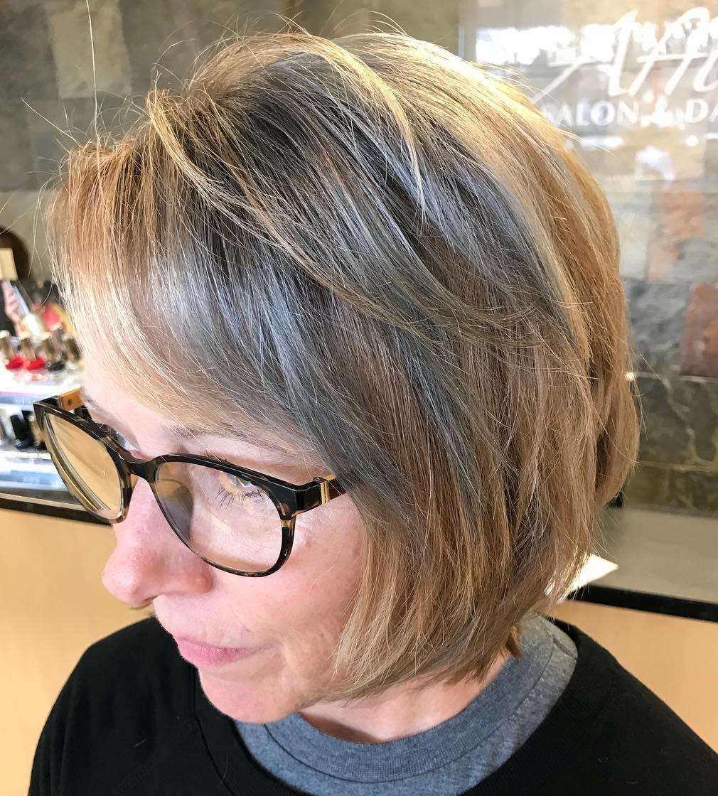 Mid-Length Gray Hairstyle with Bangs and Glasses