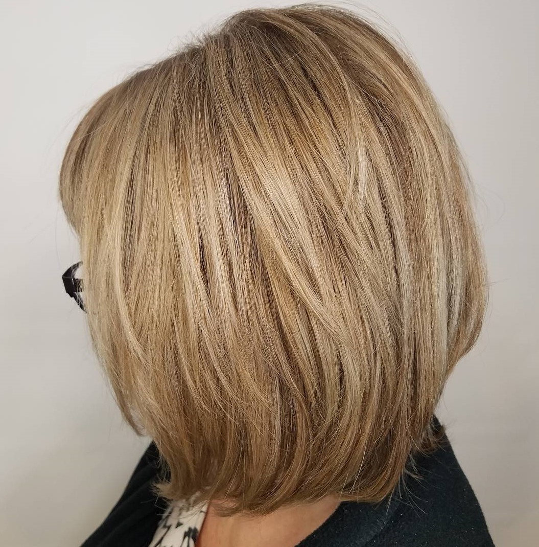 Over 60 Blonde Layered Bob with Bangs and Glasses