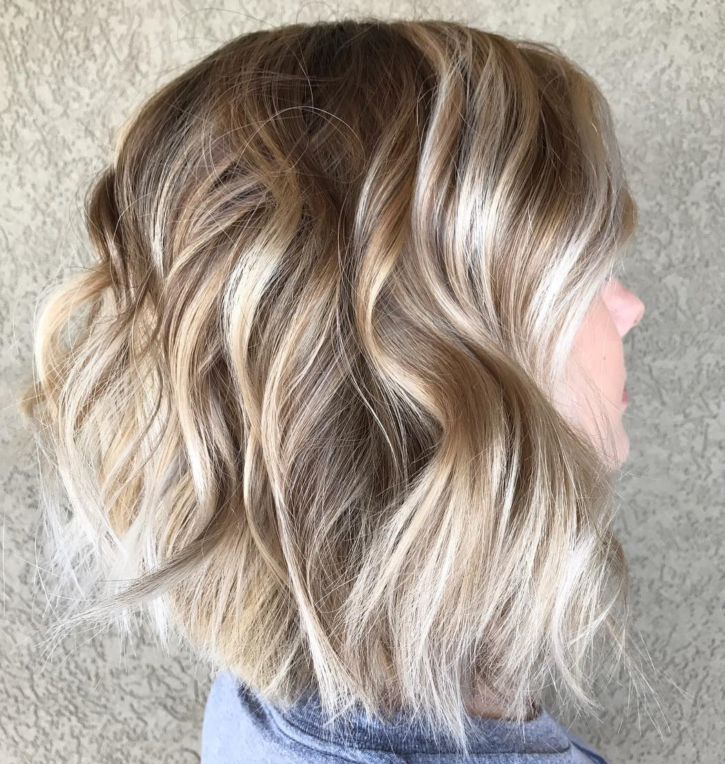 Voluminous Wavy Choppy Lob with Highlights