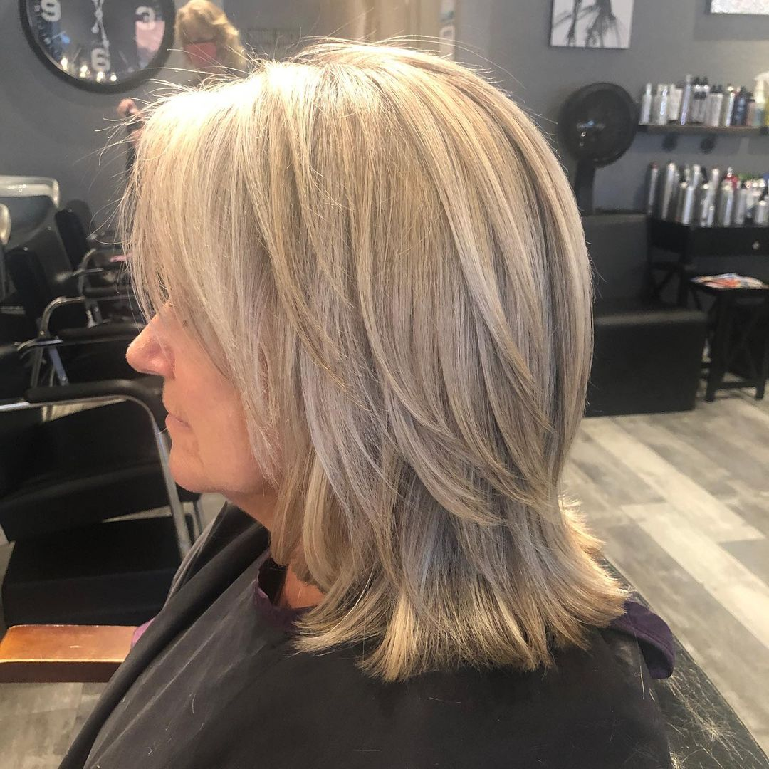 Medium Layered Haircut for 60-Year-Old Women