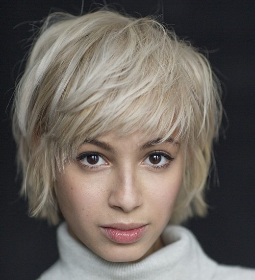 Short Blonde Layered Hairstyle with Bangs