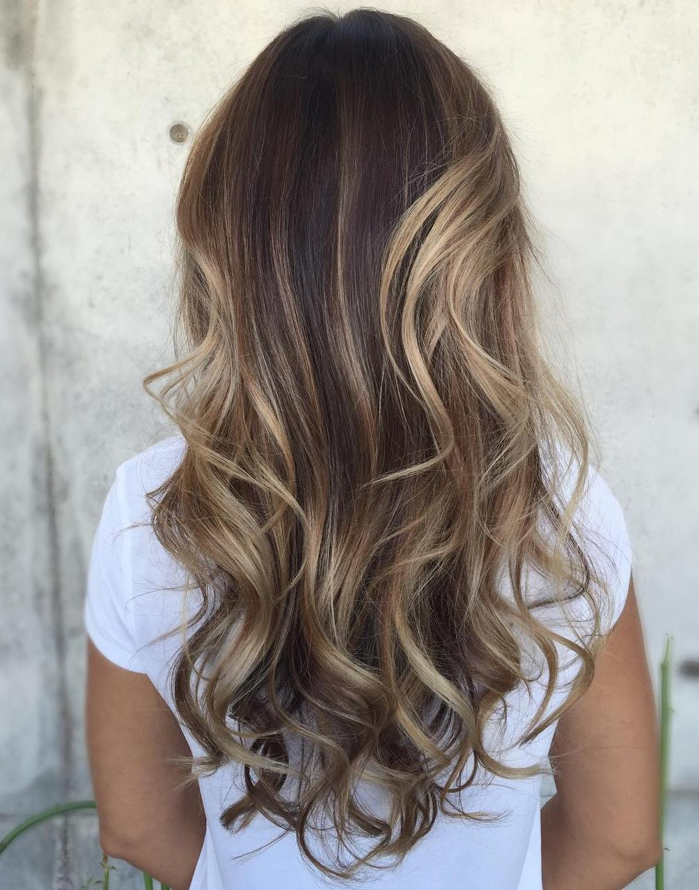 Subtle Sandy Blonde Highlights for Wavy Dark Brown Hair