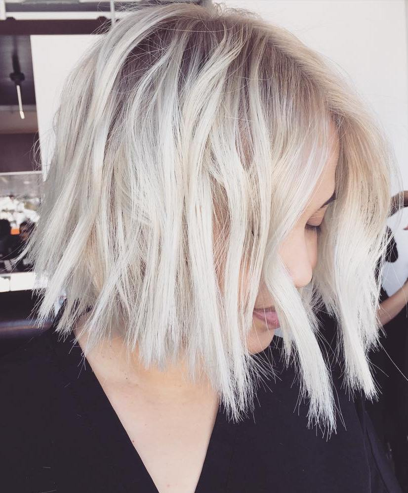 Choppy Platinum Blonde Bob with Shadow Roots