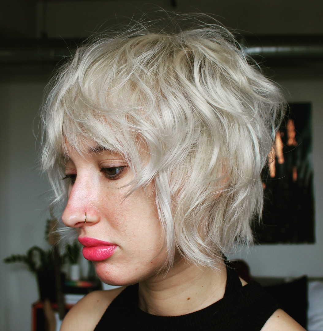 Short Blonde Inverted Tousled Shag with Bangs