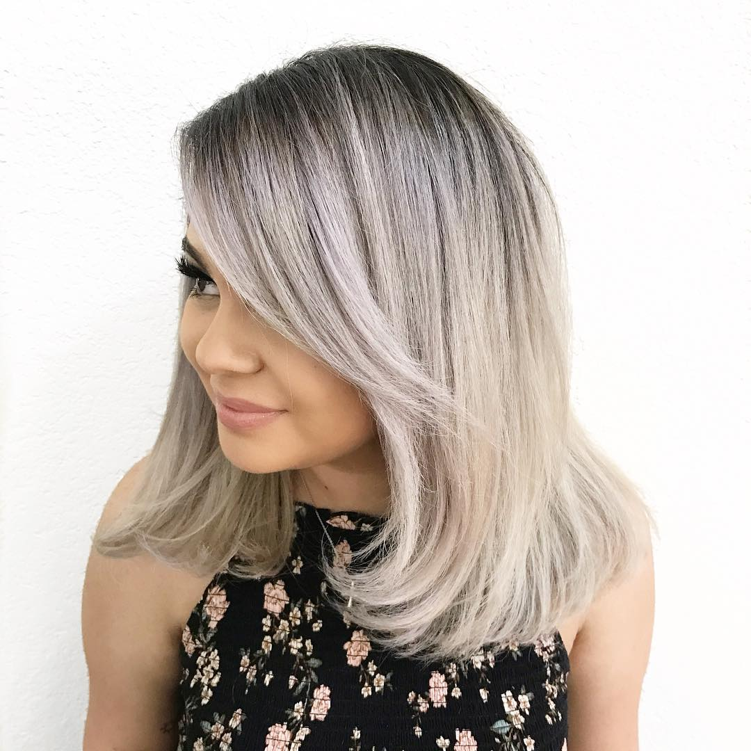 Medium Straight Blonde Hairstyle with Bangs