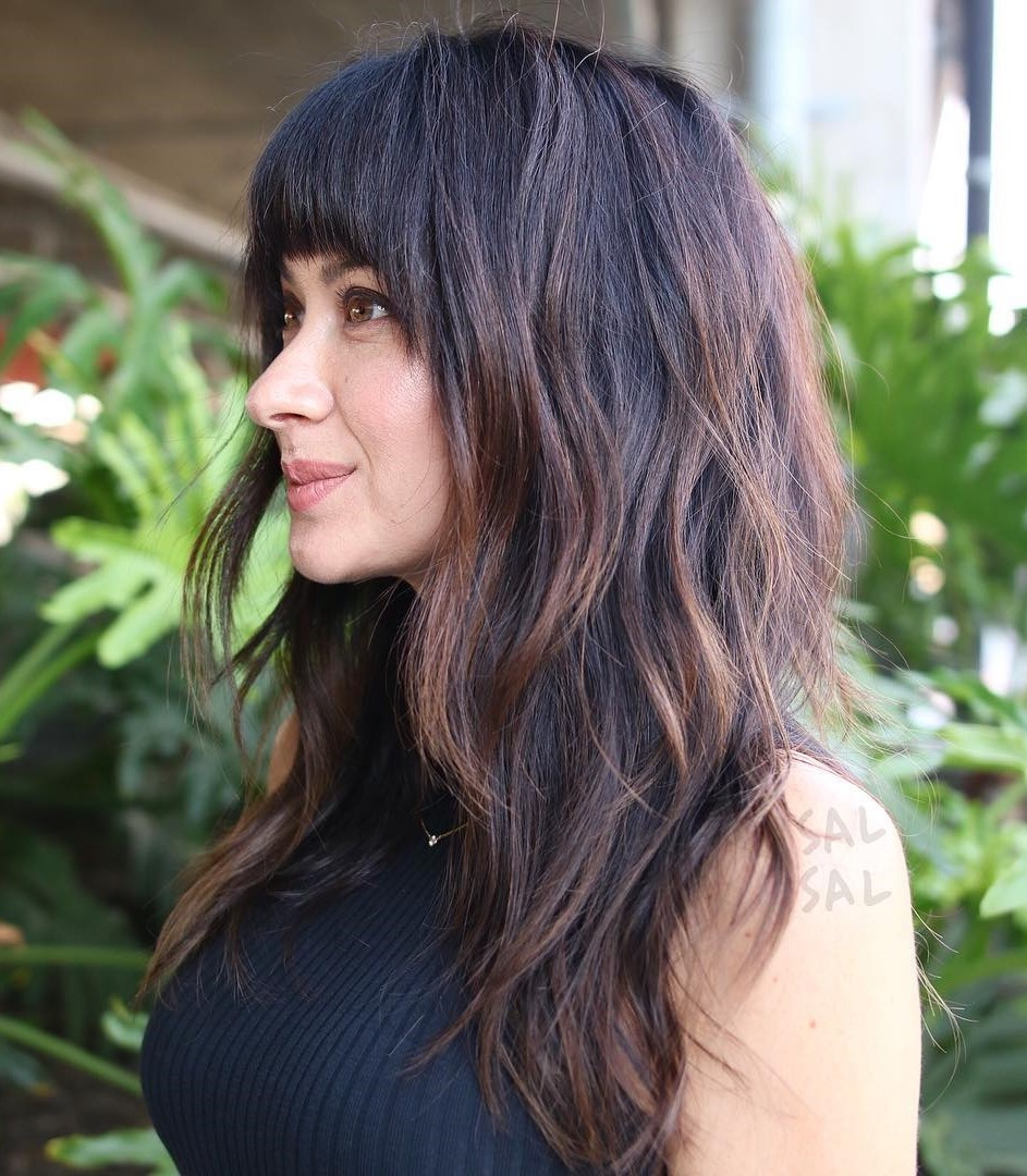 Long Layered Cut with Face-Framing Bangs