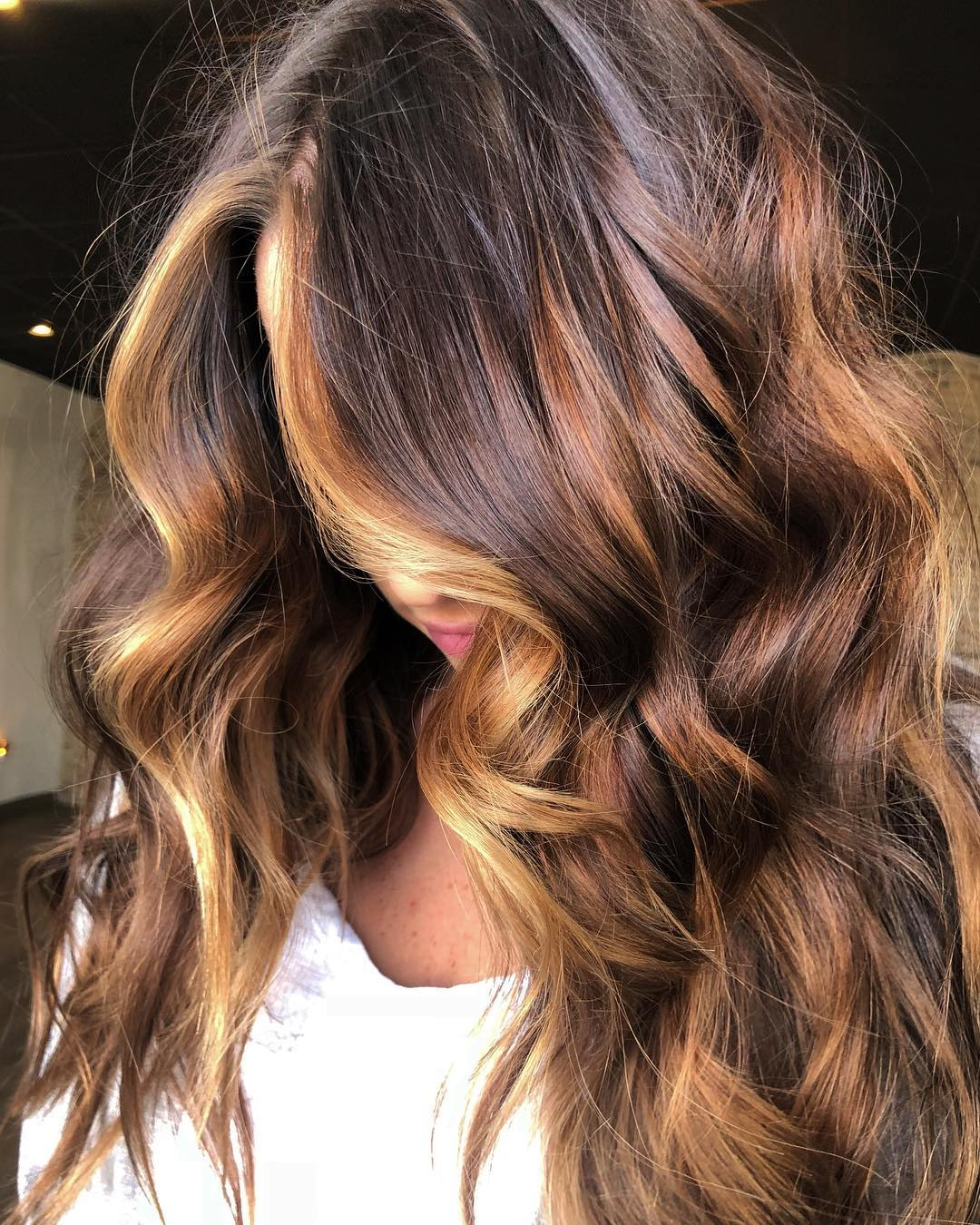 Rose-Gold Streaks for Dark Hair