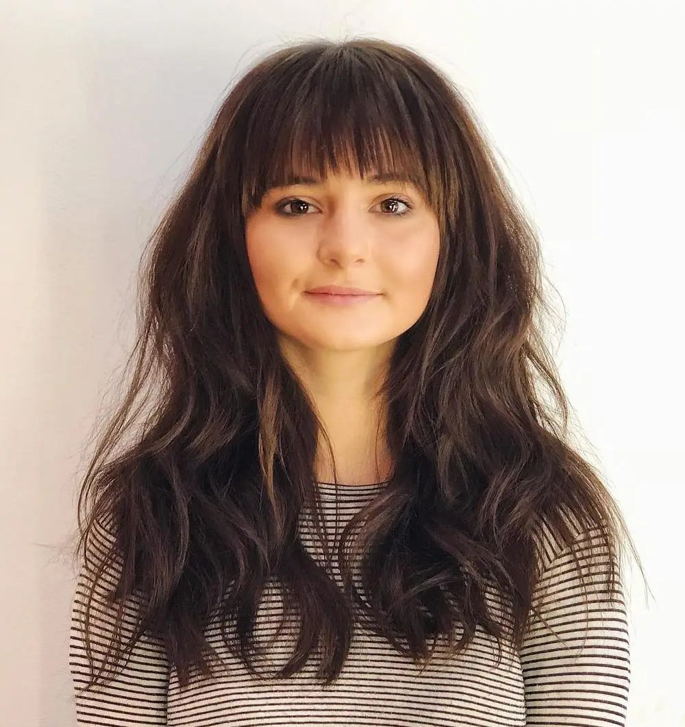 Wavy Hairstyle with Straight Bangs