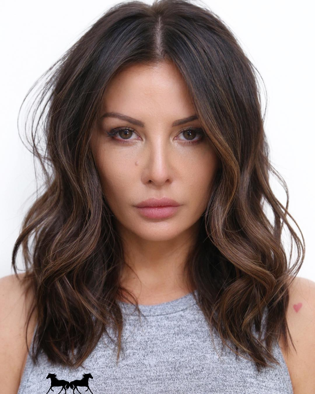 dark brown hair with highlights