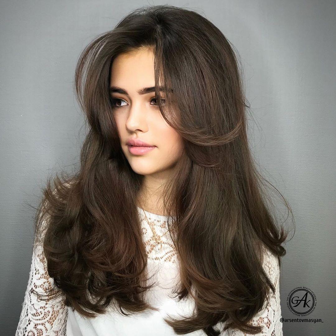 Long Voluminous Hair with Side Bangs