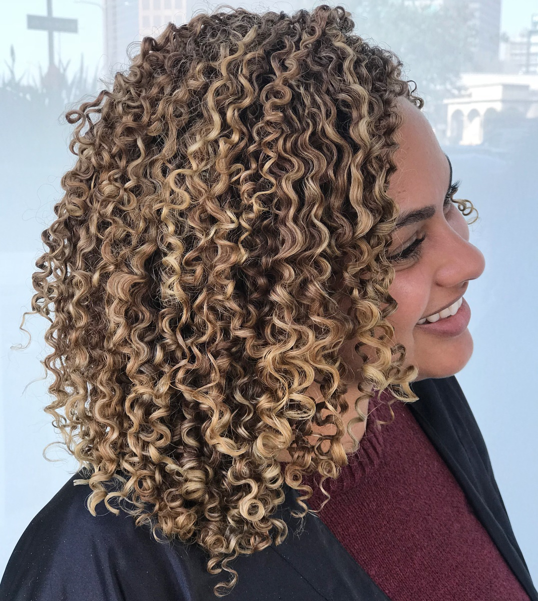 Rounded Medium Length Curly Hairstyle