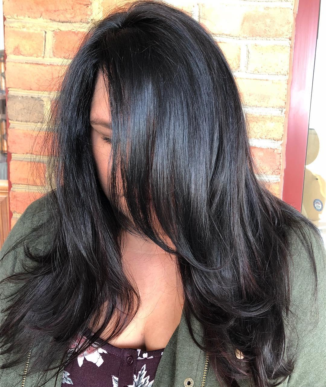 Voluminous Black Hairstyle with Long Bangs