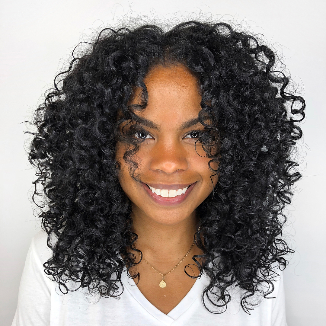 Center-Parted Curly Layered Haircut