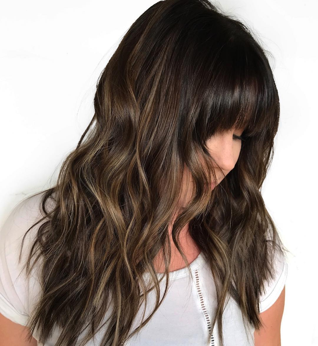 Long Wavy Haircut with Full Bangs