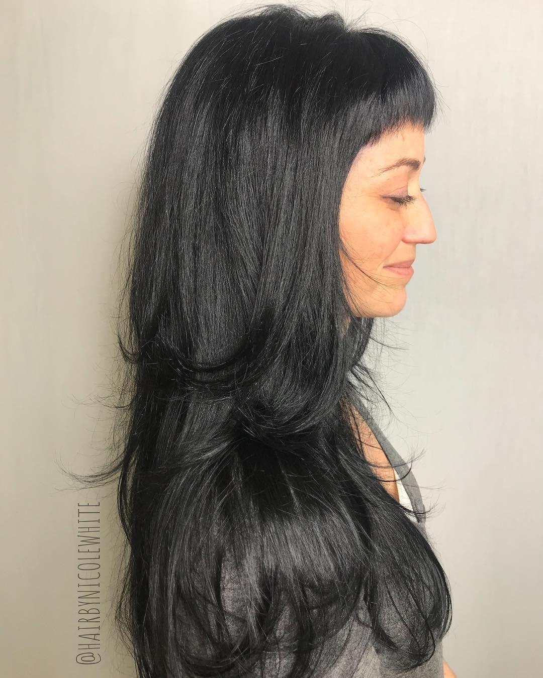 Long Layered Haircut with Baby Bangs