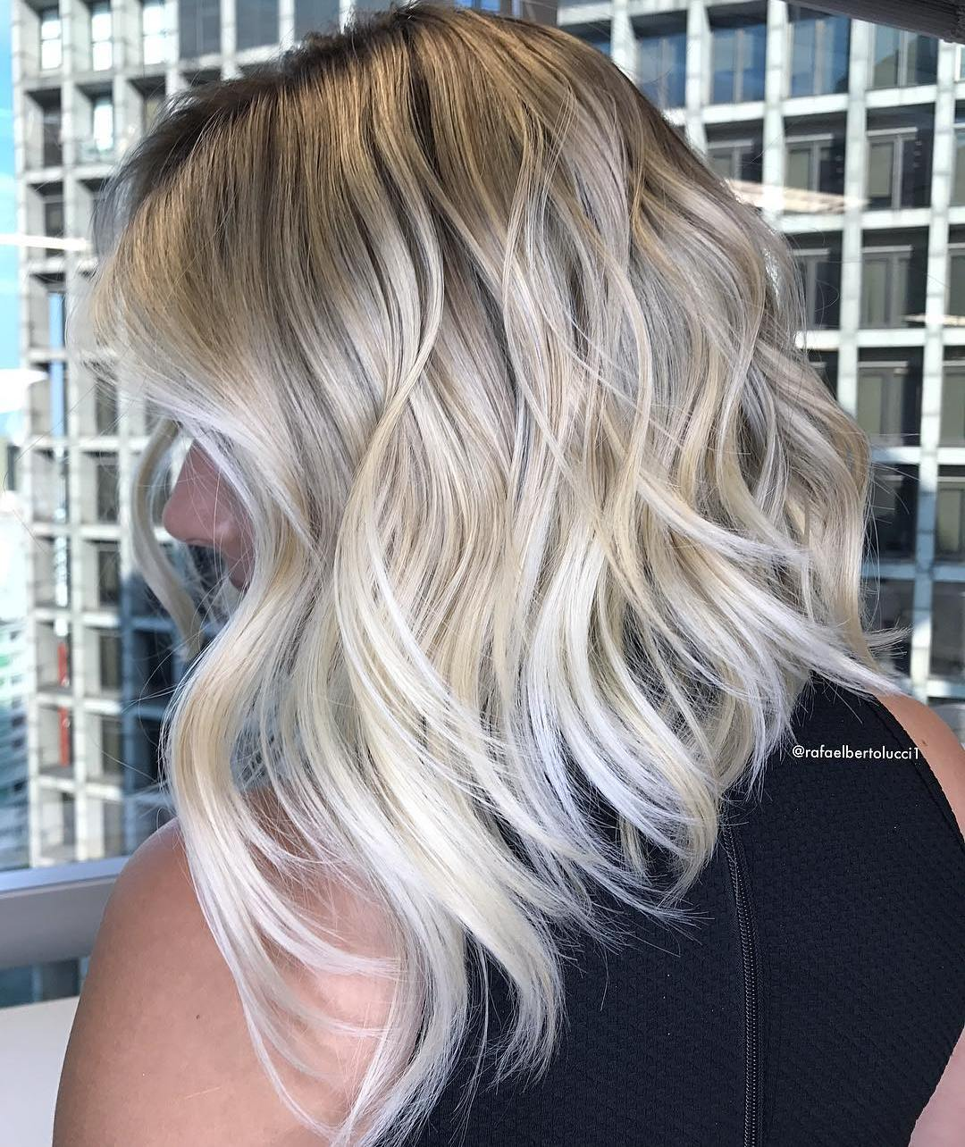 Angled Blonde Lob with Highlights