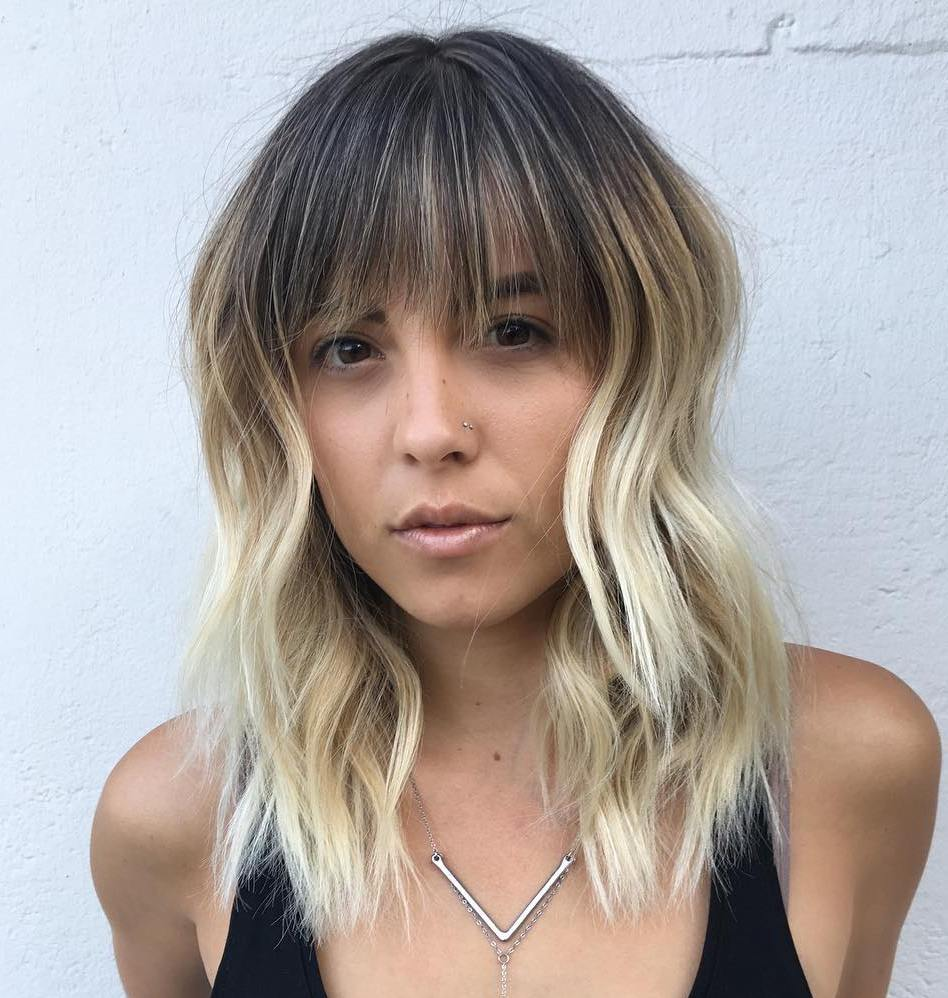 Edgy Textured Wavy Haircut with Bangs