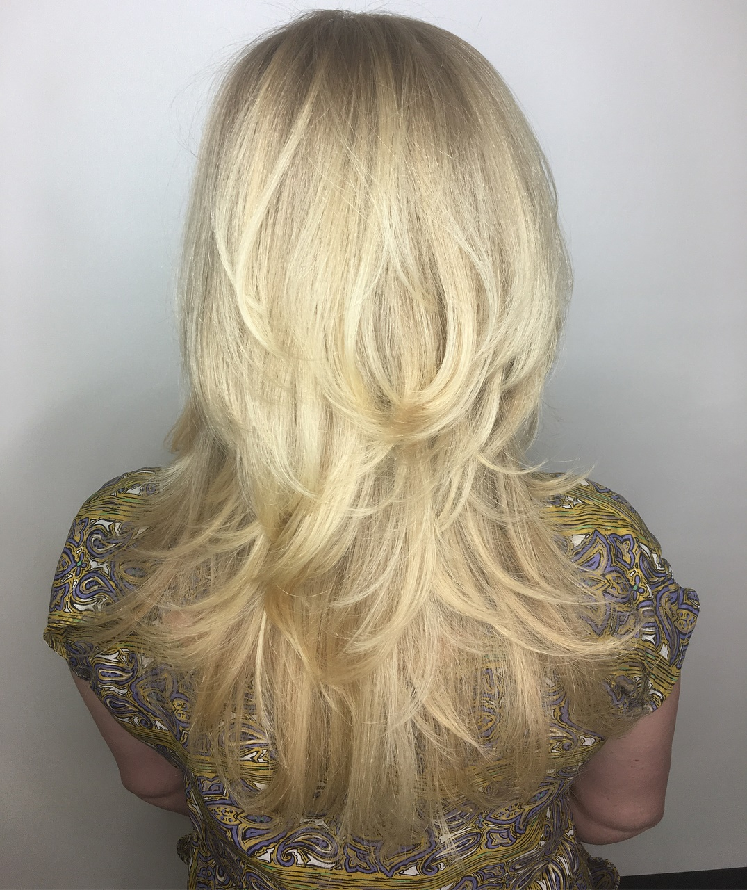 Feathered Blonde Cut for Long Hair