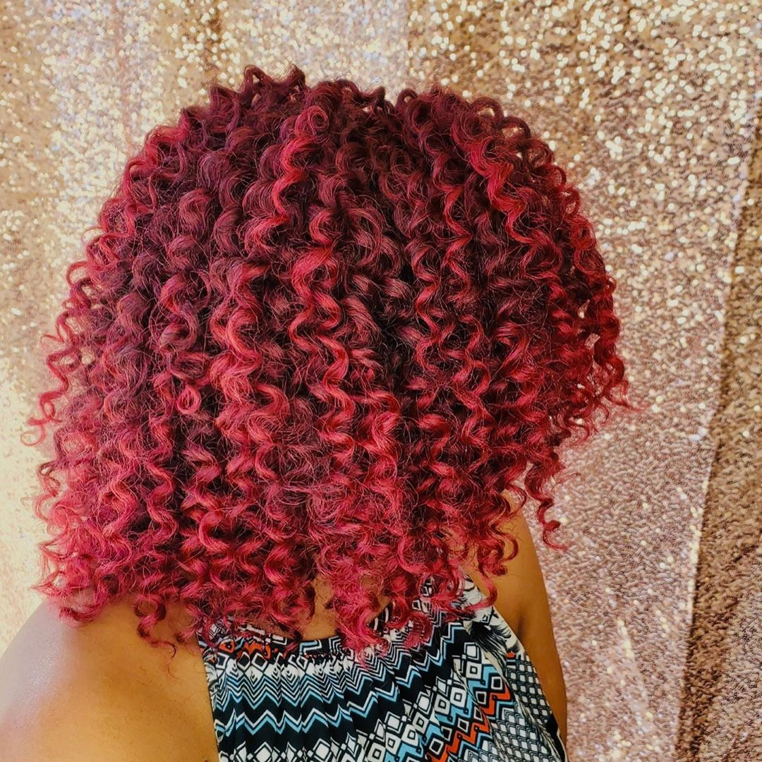 Curly Burgundy Hair with Crimson Highlights