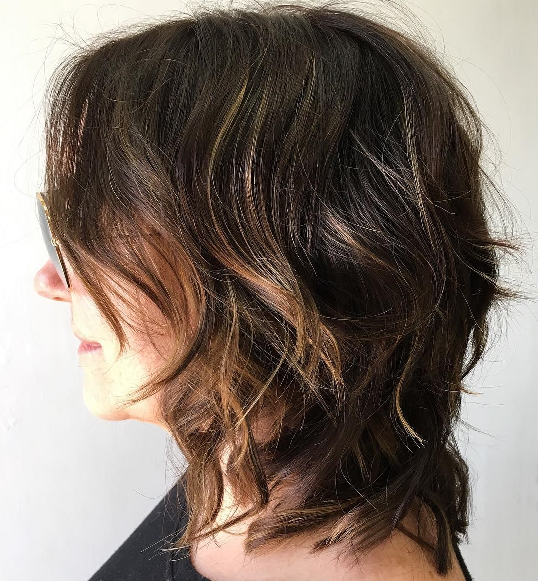 Dark Shaggy Layered Haircut with Auburn Highlights