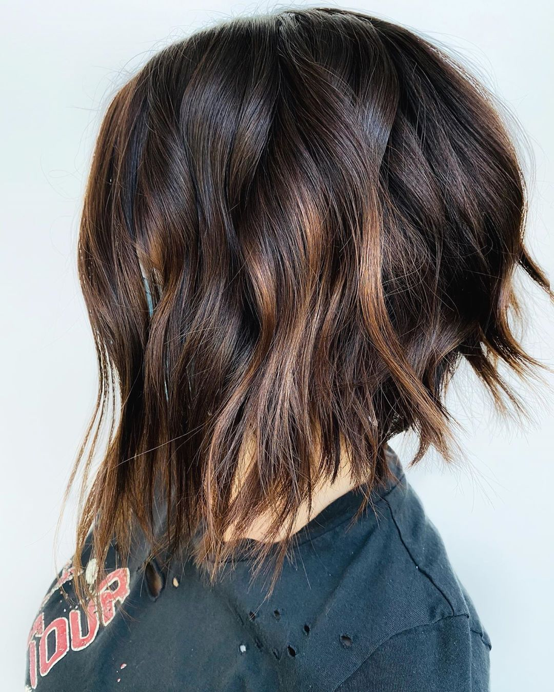Short Dark Beachy Waves with Caramel Highlights