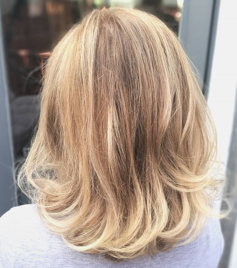Medium Blonde Hair with Subtle Highlights
