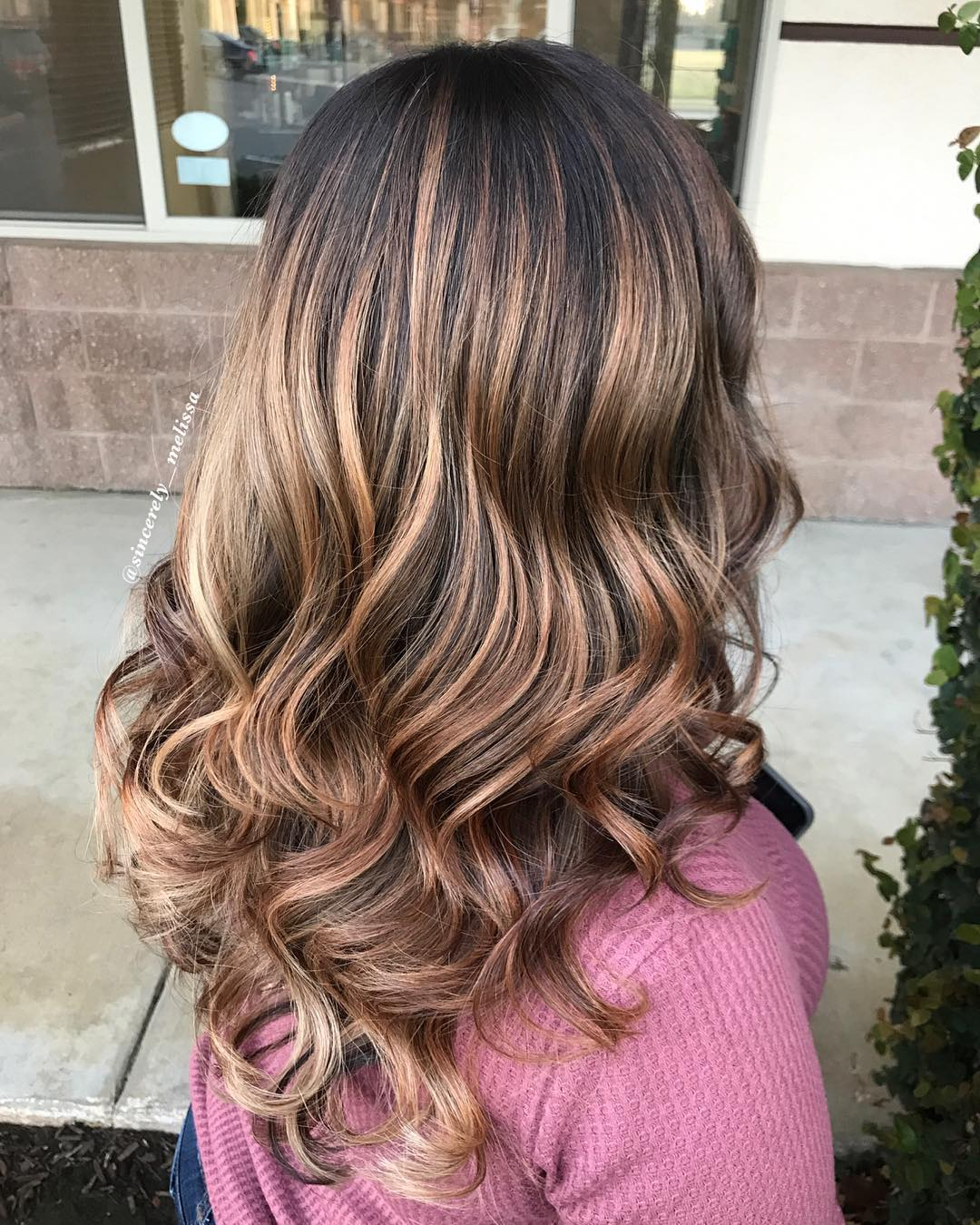 Long Caramel Waves with Dark Roots