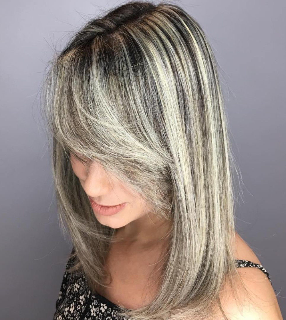 Medium Blonde Hairstyle with a Side Fringe