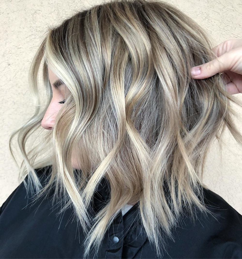 Piece-y Blonde Bob with Highlights